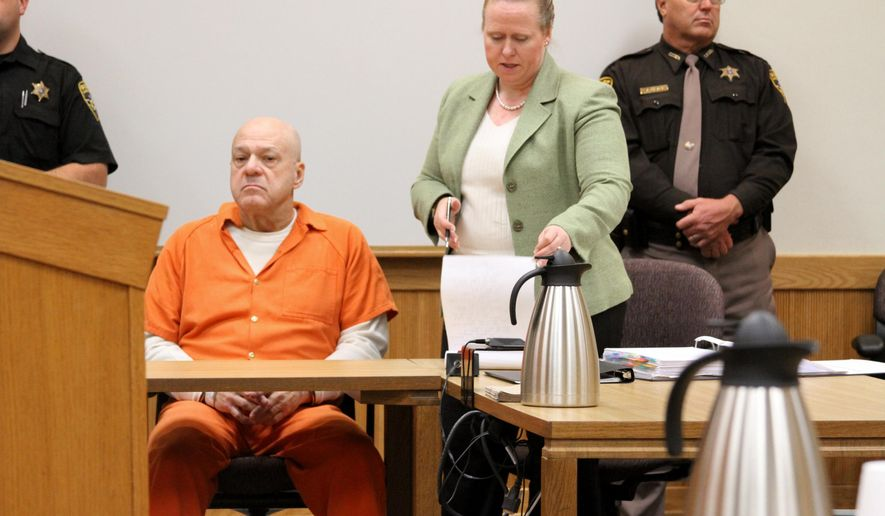 Martin Zale, 69, sits shackled at the defense table as he listens to his attorney, Melissa Pearce, address the 53rd District Court in Howell, Mich., Friday, Nov. 21, 2014. Judge Carol Sue Reader has ordered Zale will stand trial for murder in a case of alleged road rage in Livingston County. Derek Flemming was shot in the head in September after getting out of his vehicle to ask Zale about his aggressive driving. (AP Photo/Daily Press & Argus, Lisa Roose-Church)