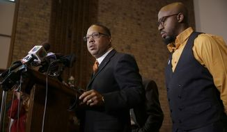 Anthony Gray, attorney for the family of Michael Brown, speaks as National Action Network Ferguson chapter president Rev. Carlton Lee, right, listens during a news conference Friday, Nov. 21, 2014, in St. Louis County, Mo. Gray and Lee spoke about preparations as citizens wait for a decision from the grand jury whether to indict Ferguson police officer Darren Wilson in the shooting of Michael Brown. (AP Photo/Jeff Roberson)