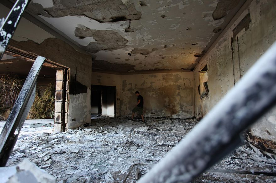In this Sept. 13, 2012 file photo, a Libyan man walks in the rubble of the damaged  U.S. consulate, after an attack that killed four Americans, including Ambassador Chris Stevens on the night of Tuesday, Sept. 11, 2012, in Benghazi, Libya. (AP photo/Mohammad Hannon, File)