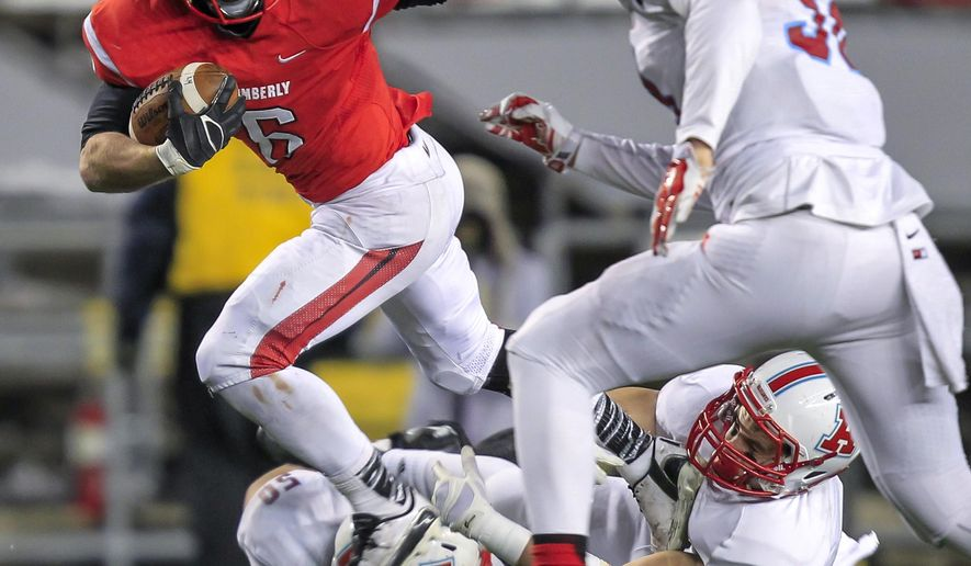 Kimberly's Blair Mulholland (6) runs against Arrowhead's Jake Powell (50), Tedy Orlando (3) and Alex Castaneda during the first half of the WIAA Division 1 high school football championship game Friday, Nov. 21, 2014, in Madison, Wis. Mulholland had 152 yards in Kimberly's 31-6 win. (AP Photo/Andy Manis)