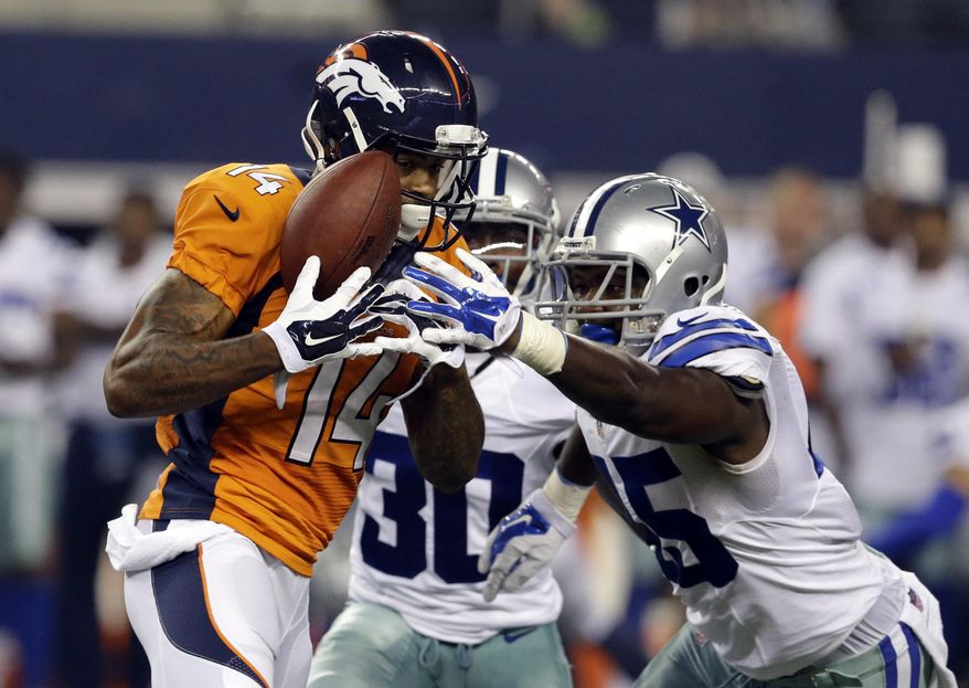 FILE - In this Aug. 28, 2014, file photo, Denver Broncos wide receiver Cody Latimer (14) grabs a pass under pressure from Dallas Cowboys cornerback Terrance Mitchell (30) and cornerback Tyler Patmon, right, in the second half of a NFL preseason football game in Arlington, Texas.  Latimer says he's ready to make an impact in Denver's complex offense, and he might just get that chance Sunday against Miami with two of Peyton Manning's top targets sidelined. (AP Photo/LM Otero, File)