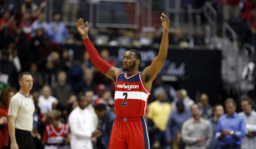 Washington Wizards guard John Wall reacts late in the second half of an NBA basketball game against the Cleveland Cavaliers, Friday, Nov. 21, 2014, in Washington. Wall had 28 points. The Wizards won 91-78. (AP Photo/Alex Brandon)