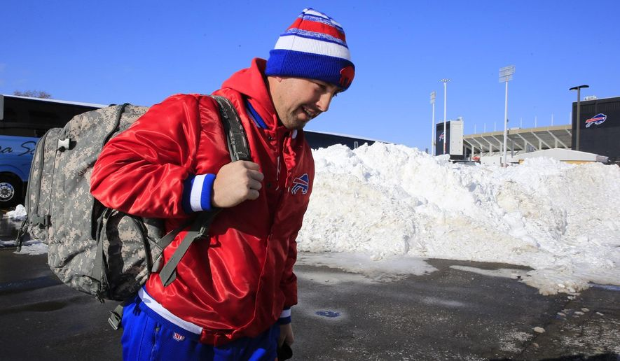 "Buffalo Bills quarterback Kyle Orton prepares to board a bus Friday, Nov. 21, 2014, in Orchard Park, N.Y., as they gets set to travel to Detroit. Snowed out in Buffalo, the Bills are heading to Detroit to play their ""home"" NFL football game against the New York Jets on Monday night, Nov. 24, 2014. (AP Photo/The Buffalo News, Harry Scull Jr.)  TV OUT; MAGS OUT; MANDATORY CREDIT; BATAVIA DAILY NEWS OUT; DUNKIRK OBSERVER OUT; JAMESTOWN POST-JOURNAL OUT; LOCKPORT UNION-SUN JOURNAL OUT; NIAGARA GAZETTE OUT; OLEAN TIMES-HERALD OUT; SALAMANCA PRESS OUT; TONAWANDA NEWS OUT"