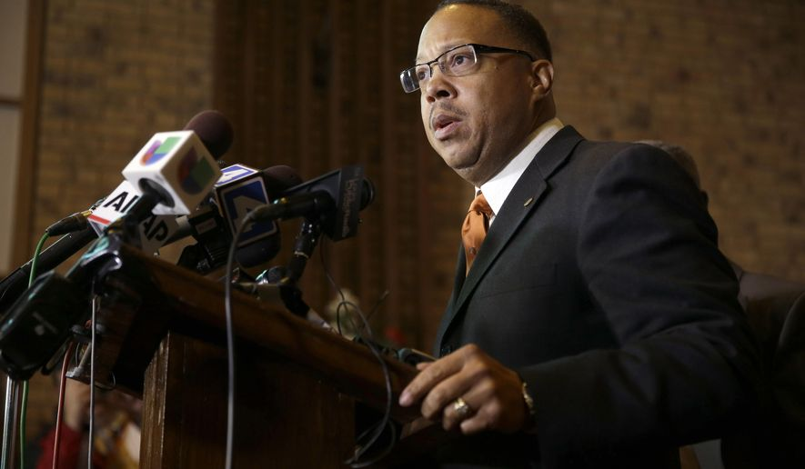 Anthony Gray, attorney for the family of Michael Brown, speaks during a news conference Friday, Nov. 21, 2014, in St. Louis County, Mo. Gray spoke about preparations as citizens wait for a decision from the grand jury whether to indict Ferguson police officer Darren Wilson in the shooting of Michael Brown. (AP Photo/Jeff Roberson)