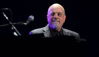 FILE - In this Jan. 27, 2014 file photo, Billy Joel performs his first show of his Madison Square Garden residency, in New York. Joel will set a new record for the most performances by any artist at Madison Square Garden with his upcoming 65th show scheduled for this summer. Tickets for the record breaking show, as well as his performances scheduled in May and June 2015, will go on sale to the general public on Saturday, Nov. 22, 2014. (Photo by Greg Allen/Invision/AP, File)