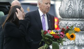 U.S. Vice President Joe Biden, right, and Myroslava Gongadze, wife of murdered opposition journalist Heorhiy Gongadze lay flowers  in honor of the protesters  who were killed in clashes with the police during the demonstrations in Kiev, Ukraine, Friday, Nov. 21, 2014. The protests known as Euromaidan were  sparked by then President Viktor Yanukovych's decision in November 2013 to freeze ties with the West and tilt toward Moscow. The protests drew hundreds of thousands, leading to a bloody crackdown by security forces in late February 2014 and the eventual ouster of Yanukovych as he fled to neighboring Russia. (AP Photo/Efrem Lukatsky)