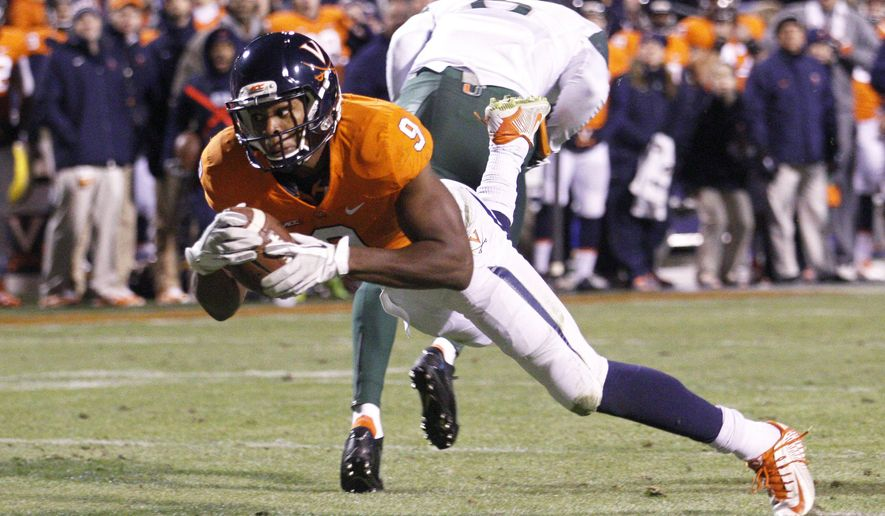 Virginia wide receiver Canaan Severin (9) dives into the end zone for a touchdown during the second quarter of an NCAA college football game against Miami, Saturday, Nov. 22, 2014, in Charlottesville, Va. (AP Photo/The Daily Progress, Ryan M. Kelly)