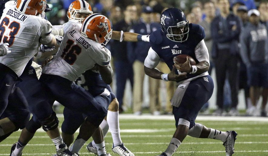 Rice quarterback Driphus Jackson, right, breaks away from UTEP defenders during the first quarter of an NCAA college football game Friday, Nov. 21, 2014, in Houston. (AP Photo/David J. Phillip)
