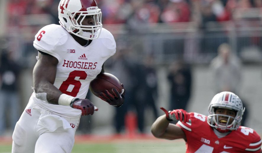 Indiana running back Tevin Coleman cuts up field against Ohio State during the second quarter of an NCAA college football game Saturday, Nov. 22, 2014, in Columbus, Ohio. Ohio State beat Indiana 42-27. (AP Photo/Jay LaPrete)
