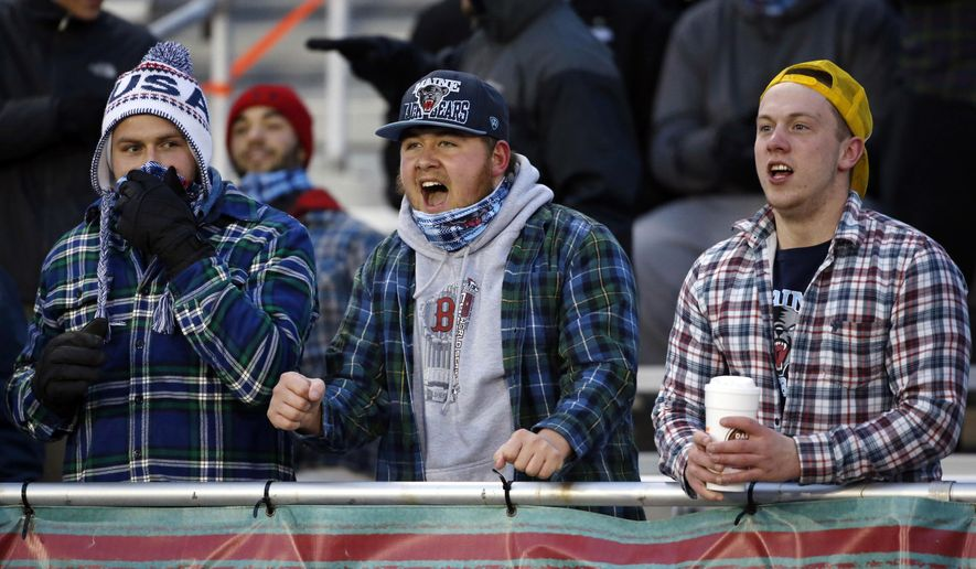 Maine fans cheer during a college football game between Maine and New Hampshire, Saturday, Nov. 22, 2014, in Orono, Maine. The school was attempting to break the Guinness world record for the most people wearing plaid-or-tartan-patterned clothing in one place but appeared to have fallen short. (AP Photo/Robert F. Bukaty)