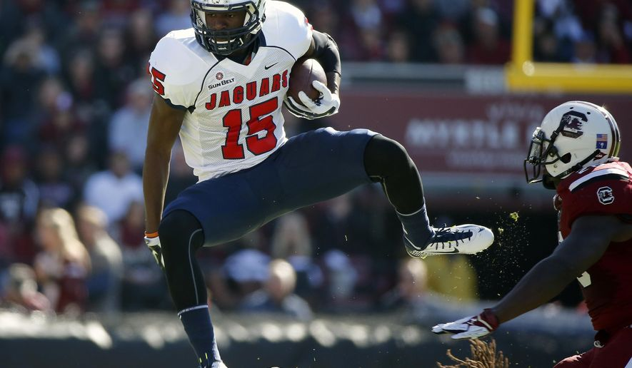 South Alabama wide receiver Cameron Broadnax (15) leaps over a defender for a gain during the first half of an NCAA college football game against South Carolina in Columbia, S.C., Saturday, Nov. 22, 2014. (AP Photo/Stephen B. Morton)