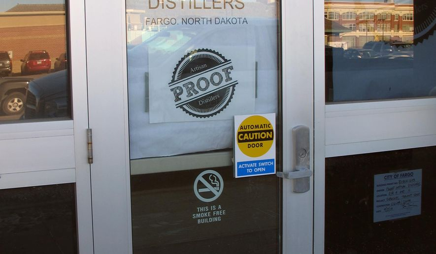 This Nov. 20, 2014 photo, construction is underway on a micro-distillery called Proof Artisan Distillers in Fargo, N.D.  The company will use Red River barley, corn and potatoes that will produce whiskeys and vodkas and feature a century-old bar from a small North Dakota town.  (AP Photo/Dave Kolpack)