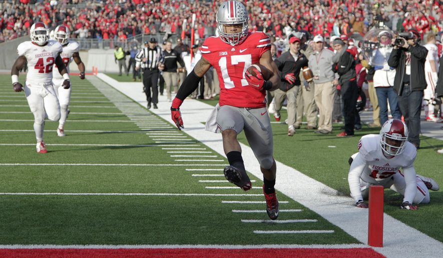 Ohio State running back Jalin Marshall (17) scores a touchdown against Indiana during the fourth quarter of an NCAA college football game Saturday, Nov. 22, 2014, in Columbus, Ohio. Ohio State won 42-27. (AP Photo/Jay LaPrete)