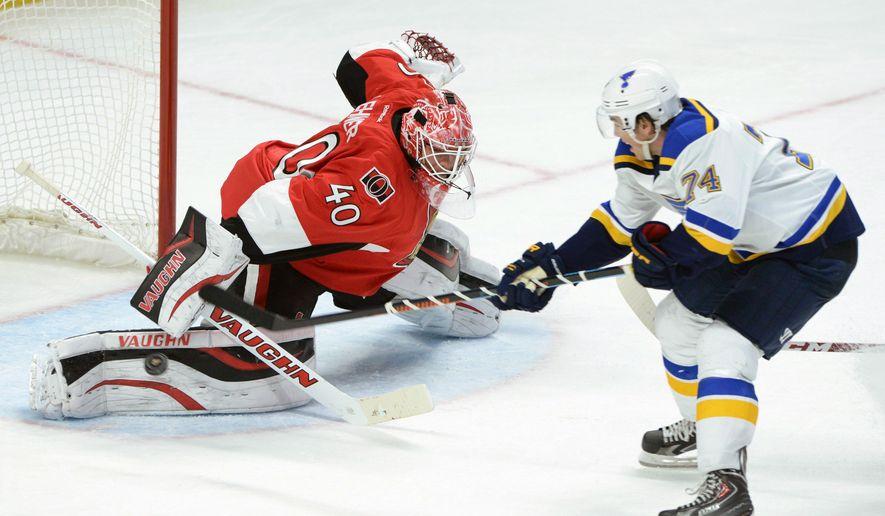 Ottawa Senators' Robin Lehner stops a breakaway shot from St. Louis Blues' T.J. Oshie during an NHL hockey game, Saturday, Nov. 22, 2014, in Ottawa, Ontario. (AP Photo/The Canadian Press, Sean Kilpatrick)