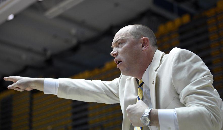 George Washington head coach Jonathan Tsipis points during the first half of an NCAA college basketball game, Saturday, Nov. 22, 2014, in Washington. Maryland won 75-65. (AP Photo/Nick Wass)