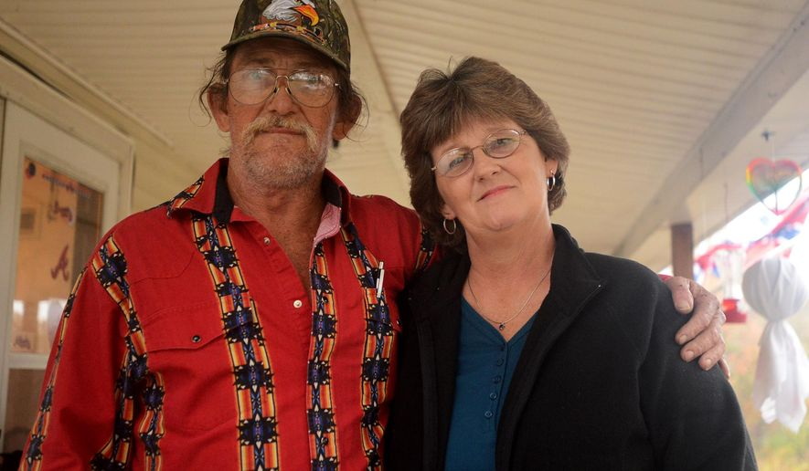 In a Nov. 5, 2014 photo, Donald Moore and Donna Brunty, who are brother and sister, pose for a photo in Jackson, Tenn. Mooore and Brunty have recently reunited after 51 years of being apart. (AP Photo/The Jackson Sun, Ken Cummings) NO SALES