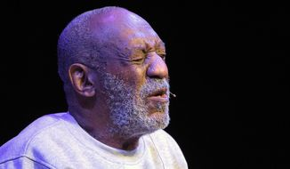 Comedian Bill Cosby performs during a show at the Maxwell C. King Center for the Performing Arts in Melbourne, Fla., Friday, Nov. 21, 2014. (AP Photo/Phelan M. Ebenhack)