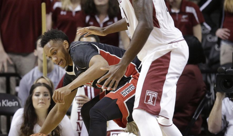 UNLV's Rashad Vaughn, left, tries to hold on to the ball during the first half of an NCAA college basketball game against Temple for third place in the Coaches vs. Cancer Classic, Saturday, Nov. 22, 2014, in New York. (AP Photo/Seth Weng)