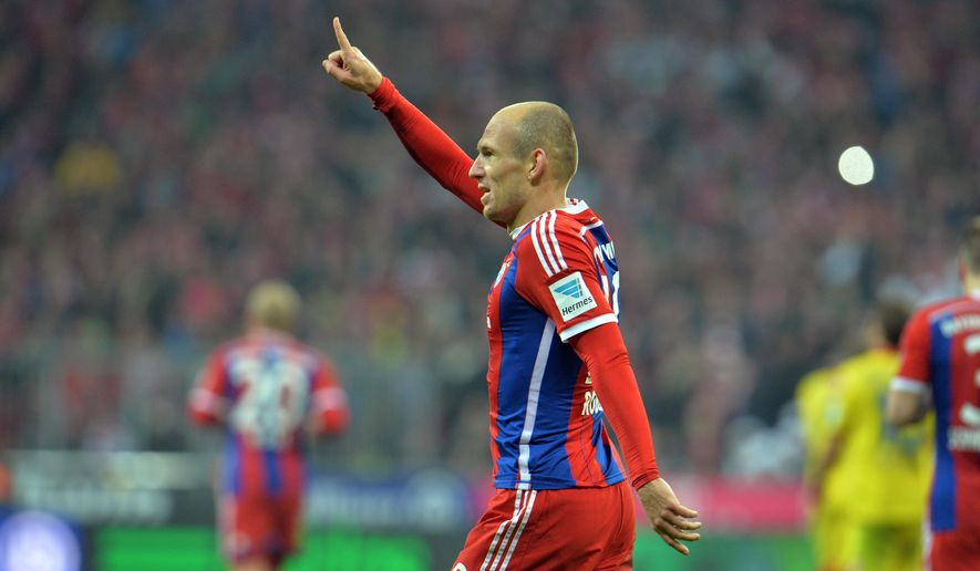 Bayern's Arjen Robben celebrates after scoring during the Bundesliga   soccer match between FC Bayern Munich and 1899 Hoffenheim in the Allianz Arena in Munich, Germany, on Saturday, Nov. 22, 2014. (AP Photo/Kerstin Joensson)