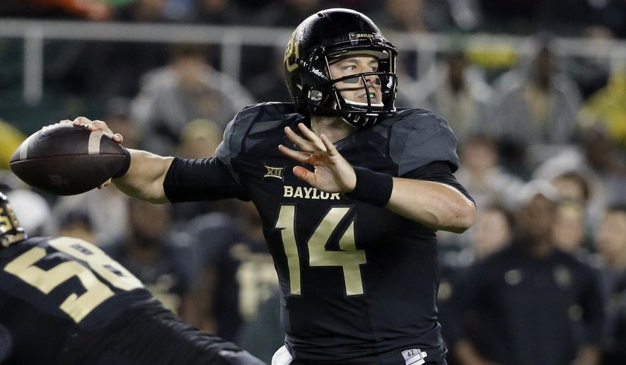 Baylor quarterback Bryce Petty (14) passes from the pocket in the first half of an NCAA college football game against Oklahoma State, Saturday, Nov. 22, 2014, in Waco, Texas. (AP Photo/Tony Gutierrez)