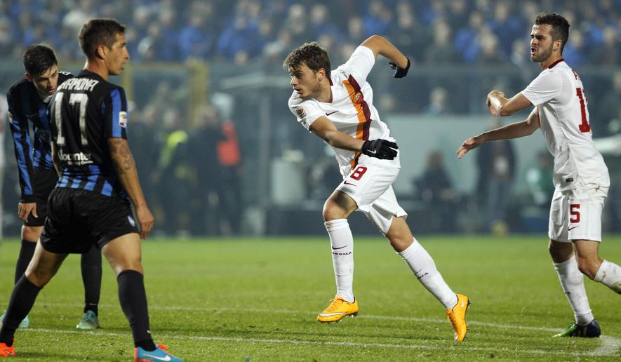 AS Roma's Adem Ljajic, second from right, celebrates after scoring during a Serie A soccer match against Atalanta in Bergamo, Italy, Saturday, Nov. 22, 2014. (AP Photo/Felice Calabro')