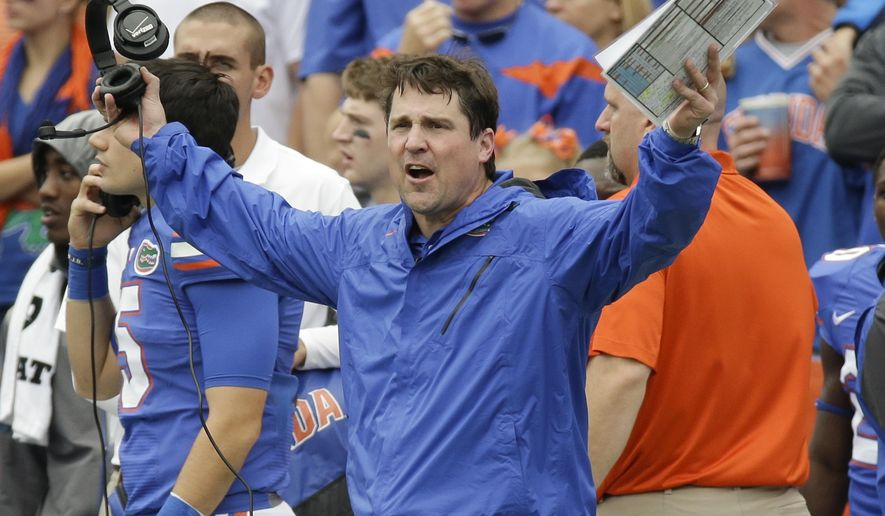 Florida head coach Will Muschamp waves his arms after disputing a call by officials during the first half of an NCAA college football game against Eastern Kentucky in Gainesville, Fla., Saturday, Nov. 22, 2014. (AP Photo/John Raoux)