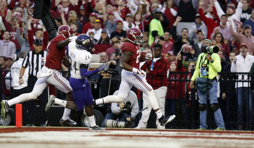 Alabama running back Derrick Henry (27) scores a touchdown during the first half an NCAA college football game against Western Carolina, Saturday, Nov. 22, 2014, in Tuscaloosa, Ala. (AP Photo/Brynn Anderson)