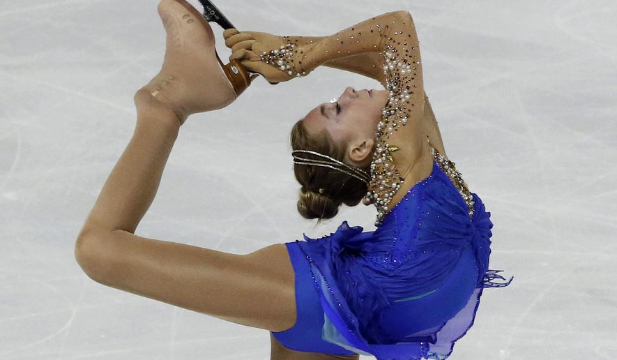 Elena Radionova of Russia, competes in the Ladies' Free Skating event, during the ISU figure skating 2014 Eric Bompard Trophy competition,  at Bordeaux's skating arena, western France, Saturday, Nov. 22, 2014. (AP Photo/Michel Euler)