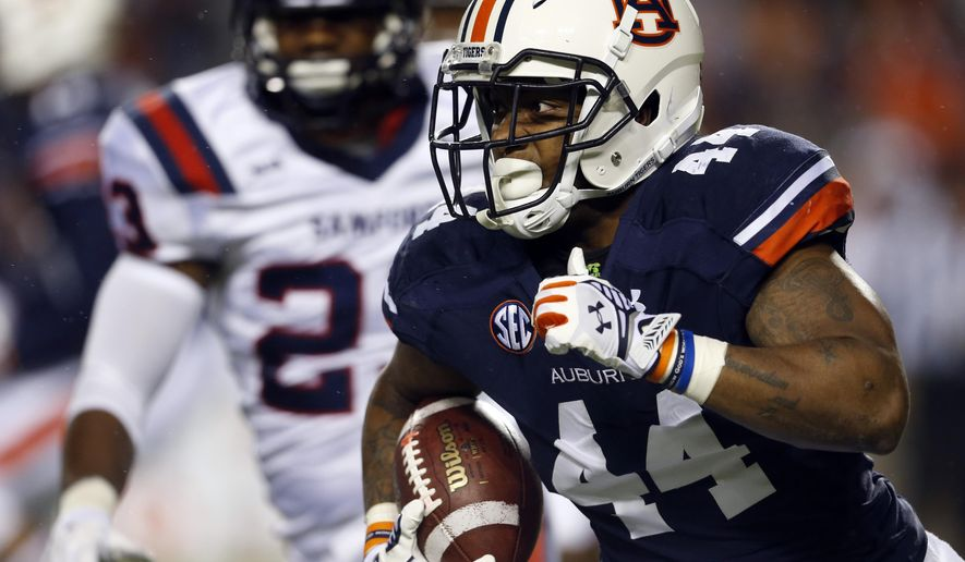 Auburn running back Cameron Artis-Payne (44) carries the ball during the first half of an NCAA college football game against Samford on Saturday, Nov. 22, 2014, in Auburn, Ala. (AP Photo/Butch Dill)