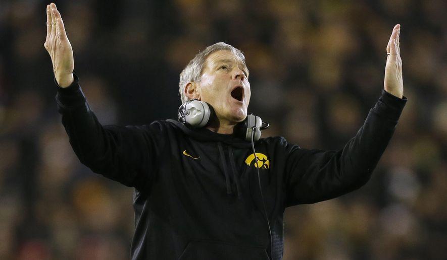 Iowa head coach Kirk Ferentz reacts during the second half of an NCAA college football game against Wisconsin, Saturday, Nov. 22, 2014, in Iowa City, Iowa. Wisconsin won 26-24. (AP Photo/Charlie Neibergall)