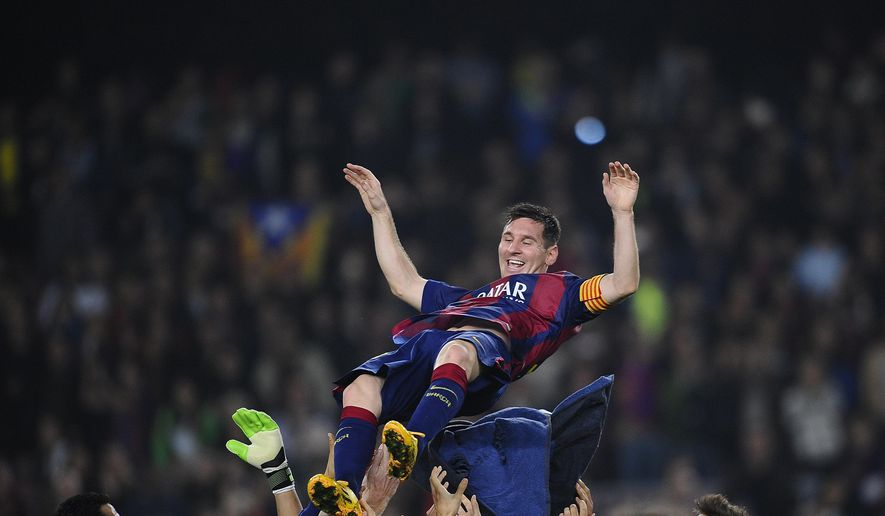 FC Barcelona's Lionel Messi, from Argentina, is lifted by his teammates after scoring against Sevilla during a Spanish La Liga soccer match between FC Barcelona and Sevilla,  at the Camp Nou stadium in Barcelona, Spain, Saturday, Nov. 22, 2014.  Messi set a La Liga scoring record of 253 goals when he claimed a hat-trick in Saturday's match at the Camp Nou stadium against Sevilla. (AP Photo/Manu Fernandez)