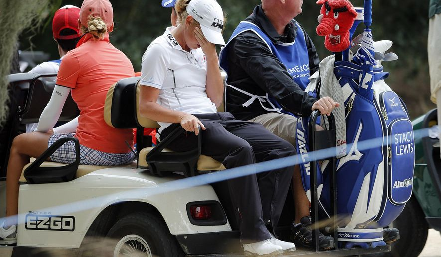 Stacy Lewis, center, reacts to her performance coming off hole 5, Friday, Nov. 21, 2014, at the Tiburon Golf Club at the Ritz-Carlton Golf Resort in Naples, Fla.  (AP Photo/Naples Daily News, Corey Perrine) FORT MYERS OUT; TV OUT; MAGAZINES OUT
