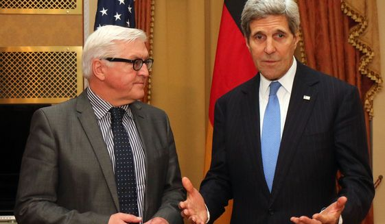 """German Foreign Minister Frank-Walter Steinmeier , left,  listens as U.S. Secretary of State John Kerry, speaks  during closed-door nuclear talks with Iran in Vienna, Saturday, Nov. 22, 2014. Iran and six world powers have """"never been closer"""" to agreement on a nuclear deal since they started negotiating more than six years ago, but it is up to Tehran to close the gap, Germany's foreign minister said Saturday. High-level comings and goings since Friday also have seen British Foreign Secretary Philip Hammond and French Foreign Minister Laurent Fabius stop by for talks with Kerry, Iranian Foreign Minister Mohammad Javad Zarif  and other participants in the negotiations.  (AP Photo/Ronald Zak)"""