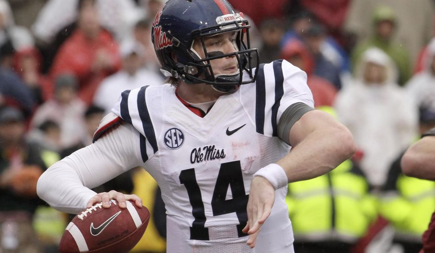 Mississippi quarterback Bo Wallace passes in the first quarter of an NCAA college football game against Arkansas Saturday, Nov. 22, 2014, in Fayetteville, Ark. (AP Photo/Danny Johnston)