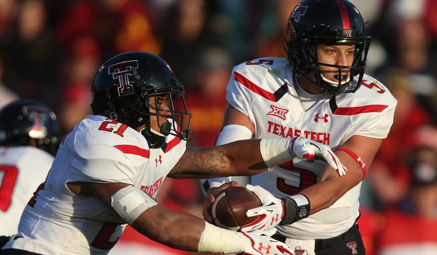 Texas Tech quarterback Patrick Mahomes looks to hand off to tailback DeAndre Washington during an NCAA college football game against Iowa State on Saturday, Nov. 22, 2014, in Ames, Iowa. (AP Photo/The Des Moines Register, Charlie Litchfield)