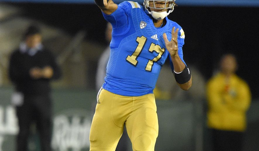 UCLA quarterback Brett Hundley passes during the first half of an NCAA college football game against Southern California, Saturday, Nov. 22, 2014, in Pasadena, Calif. (AP Photo/Mark J. Terrill)