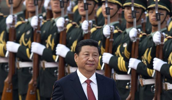 Chinese President Xi Jinping inspects a guard of honor outside the Great Hall of the People in Beijing, January, 2010. (Associated Press) ** FILE **