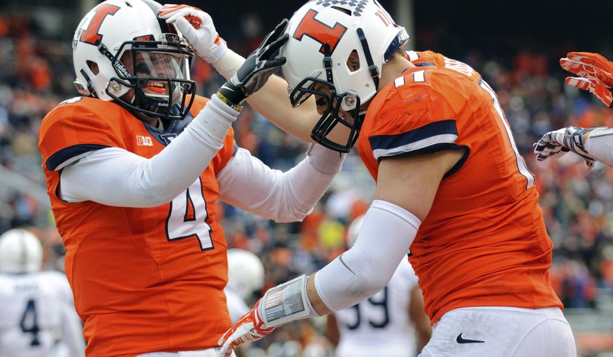 Illinois tight end Matt LaCosse (11) is congratulated by quarterback Reilly O'Toole (4) after LaCosse's touchdown reception during the second quarter of an NCAA football game against Penn State, Saturday, Nov. 22, 2014, at Memorial Stadium in Champaign, Ill. (AP Photo/Bradley Leeb)