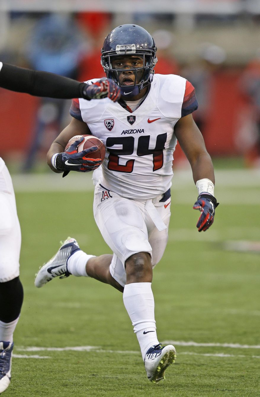 Arizona running back Terris Jones-Grigsby (24) carries the ball in the first quarter during an NCAA college football game against Utah, Saturday, Nov. 22, 2014, in Salt Lake City. (AP Photo/Rick Bowmer)