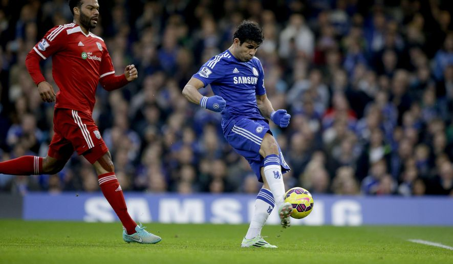 Chelsea's Diego Costa, right, scores his side's first goal under pressure from West Bromwich Albion's Joleon Lescott during the English Premier League soccer match between Chelsea and West Bromwich Albion at Stamford Bridge stadium in London, Saturday, Nov. 22, 2014.  (AP Photo/Matt Dunham)