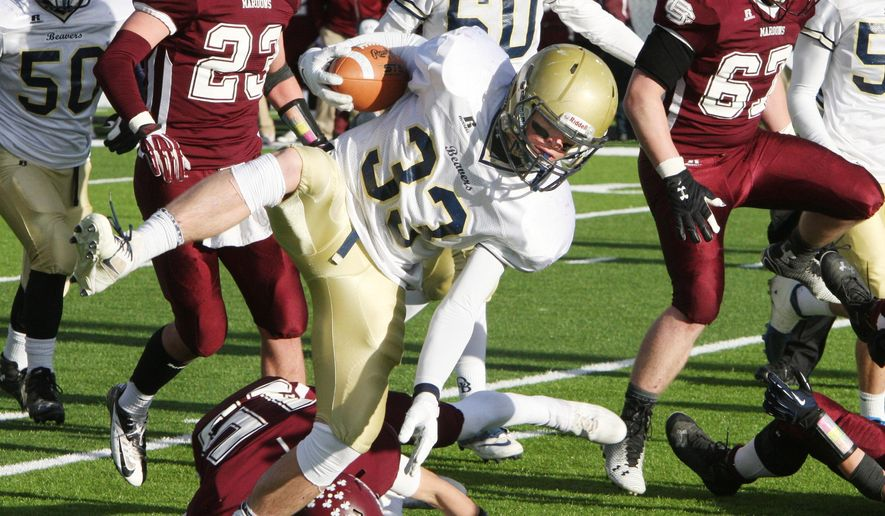 Dillon running back Jason Ferris breaks a tackle and runs for a touchdown against Butte Central during the state Class A football championship game Saturday, Nov. 22, 2014, in Butte, Mont. A 2-point conversion gave Dillon a 29-28 win. (AP Photo/Montana Standard, Walter Hinick)