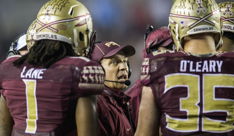 Florida State head coach Jimbo Fisher, center, talks with his offense in the fourth quarter of an NCAA college football game in Tallahassee, Fla., Saturday, Nov. 22, 2014.  Florida State won 20-17.  (AP Photo/Mark Wallheiser)