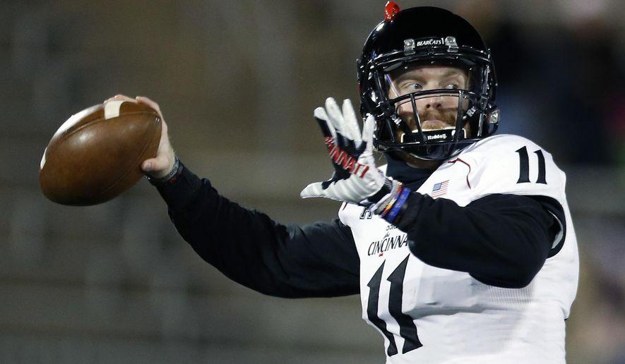 Cincinnati quarterback Gunner Kiel (11) warms up before an NCAA college football game against Connecticut in East Hartford, Conn., Saturday, Nov. 22, 2014. (AP Photo/Michael Dwyer)