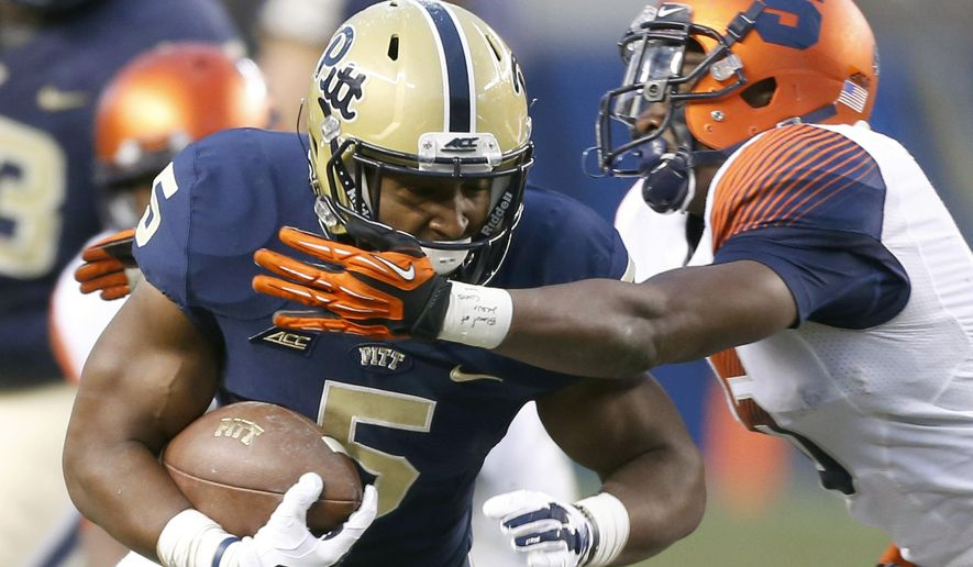 Pittsburgh running back Chris James (5) is hit by Syracuse linebacker Luke Arciniega (5) in the second quarter of an NCAA college football game, Saturday, Nov. 22, 2014, in Pittsburgh. Pittsburgh won 30-7. (AP Photo/Keith Srakocic)