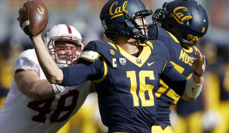 California quarterback Jared Goff (16) passes under pressure from Stanford's Kevin Anderson, left, during the first half of an NCAA college football game Saturday, Nov. 22, 2014, in Berkeley, Calif. (AP Photo/Ben Margot)