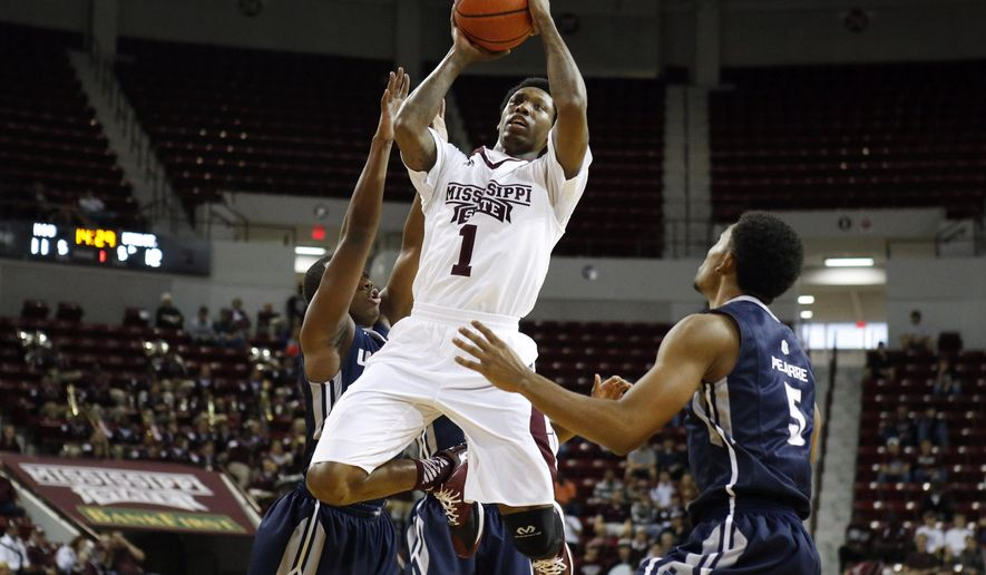 Mississippi State guard Fred Thomas (1) shoots over Utah State defenders including guard Julion Pearre (5) during the first half of an NCAA college basketball game, Saturday, Nov. 22, 2014, in Starkville, Miss. (AP Photo/Rogelio V. Solis)
