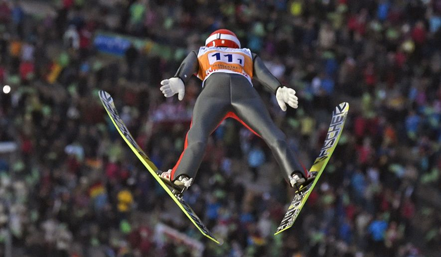 Markus Eisenbichler of Germany competes in front of the spectators during the team competition at the FIS Ski Jumping World Cup in Klingenthal, Germany, Saturday, Nov. 22, 2014. Germany won the competition. (AP Photo/Jens Meyer)