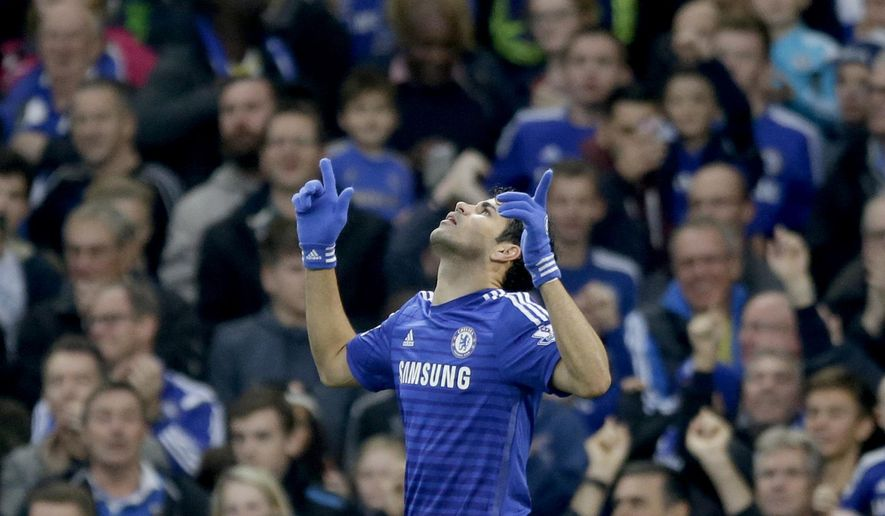 Chelsea's Diego Costa celebrates scoring his side's first goal during the English Premier League soccer match between Chelsea and West Bromwich Albion at Stamford Bridge stadium in London, Saturday, Nov. 22, 2014.  (AP Photo/Matt Dunham)