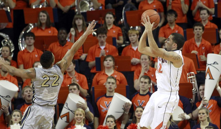 Virginia guard London Perrantes (32) shoots over George Washington guard Joe McDonald (22) during the first half of an NCAA college basketball game Friday, Nov. 21, 2014, in Charlottesville, Va. (AP Photo/Andrew Shurtleff)