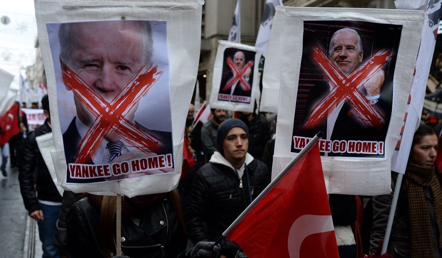 Turkish students stage a rally to protest against the visit of U.S. Vice President Joe Biden in Istanbul, Turkey, Saturday, Nov. 22, 2014.  Biden on Saturday called on Europe to continue diversifying its energy supplies to reduce dependence on Russia. (AP Photo)